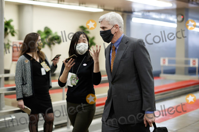Cassidy Photo - Senator Bill Cassidy a Republican from Louisiana wears a protective mask while speaking with a member of the press in the Senate Subway at the US Capitol in Washington DC US on Thursday Feb 11 2021 House prosecutors used the second day of Donald Trumps impeachment trial to detail a months-long campaign by the former president to stoke hatred and encourage violence over the election results that they said culminated in the mob attack on the US Capitol that he then did little to stopCredit Ting Shen - Pool via CNPAdMedia