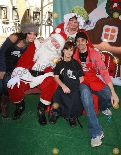 Gilles Marini Photo - 24 December 2010 - Los Angeles CA - Gilles Marini (R) with wife Carole Marini and son George Marini Christmas Eve For Homeless Served at Los Angeles Mission held At The Los Angeles Mission Photo Kevan BrooksAdMedia