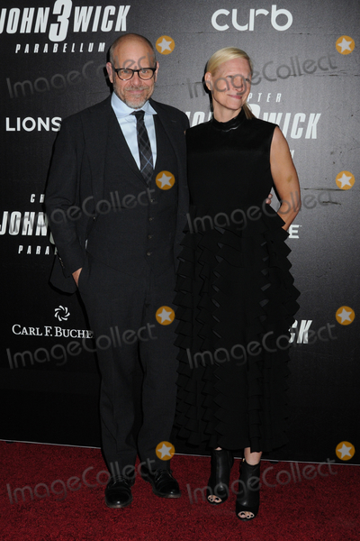Alton Brown Photo - Alton Brown and guest at the World Premiere of John Wick Chapter 3 Parabellum held at One Hanson in Brooklyn New York USA 09 May 2019