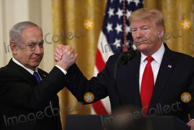 Benjamin Netanyahu Photo - United States President Donald J Trump shake hands with Israels Prime Minister Benjamin Netanyahu during a meeting in the East Room of the White House in Washington DCon Tuesday January 28 2020 Credit Joshua Lott  CNPAdMedia
