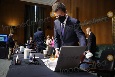Pete Buttigieg Photo - WASHINGTON DC - APRIL 20 United States Secretary of Transportation Pete Buttigieg prepares to testify before the Senate Appropriations Committee in the Dirksen Senate Office Building on Capitol Hill on April 20 2021 in Washington DC Members of President Bidens cabinet are testifying about the American Jobs Plan the administrations 23 trillion infrastructure plan that has yet to win over a single Republican in CongressCredit Chip Somodevilla   Pool via CNP