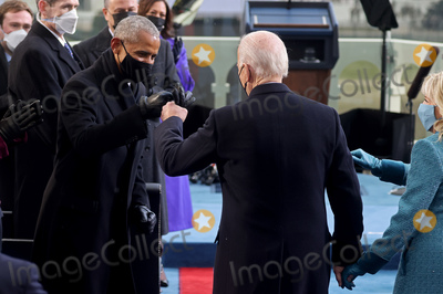 President Barack Obama Photo - President-elect Joe Biden bumps fists with former US President Barack Obama during Bidens inauguration as the 46th President of the United States on the West Front of the US Capitol in Washington US January 20 2021 REUTERSJonathan ErnstPool