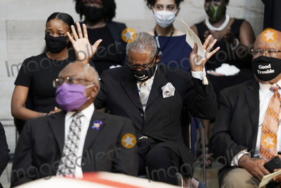 The Ceremonies Photo - United States Representative Gregory Meeks (Democrat of New York) raises his hands as Amazing Grace is played during the ceremony for the late US Representative John Lewis (Democrat of Georgia) a key figure in the civil rights movement and a 17-term congressman from Georgia at the Capitol in Washington Monday July 27 2020Credit J Scott Applewhite  Pool via CNPAdMedia