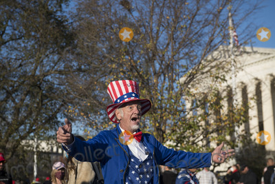 Supremes Photo - Duane Schwingel plays the part of Uncle Sam and sings for tips as thousands of supporters of United States President Donald J Trump fill the streets in front of the United States Supreme Court and the grounds of the US Capitol following a pro-Trump MAGA rally and march in Washington DC on Saturday November 14 2020Credit Rod Lamkey  CNPAdMedia