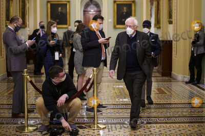 Bernie Sanders Photo - Senator Bernie Sanders an Independent from Vermont wears a protective mask while walking through the US Capitol in Washington DC US on Saturday Feb 13 2021 The Senate voted to consider a request for witnesses at Donald Trumps impeachment trial injecting a chaotic new element that could end up prolonging proceedings that appeared to be on track to wrap up today Credit Ting Shen - Pool via CNPAdMedia