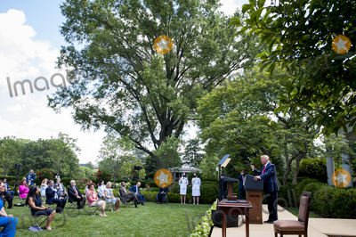 Donald Trump Photo - US President Donald Trump signs an Executive Order on The White House Hispanic Prosperity Initiative in the Rose Garden at The White House in Washington DC Thursday July 9 2020 Credit Rod LamkeyCNPAdMedia