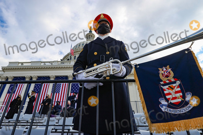 The Unit Photo - WASHINGTON DC - JANUARY 20 A member of the US Army Band Pershings Own looks on ahead of the inauguration of US President-elect Joe Biden on the West Front of the US Capitol on January 20 2021 in Washington DC  During todays inauguration ceremony Joe Biden becomes the 46th president of the United States Credit Tasos Katopodis  Pool via CNPAdMedia