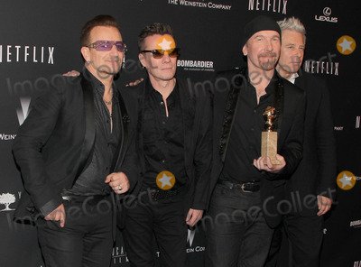 Adam Clayton Photo - 12 January 2014 - Beverly Hills California - Bono Larry Mullen Jr The Edge and Adam Clayton U2 The Weinstein Company  Netflix 2014 Golden Globes After Party celebrating the 71st Annual Golden Globe Awards held at the Beverly Hilton Hotel Photo Credit Kevan BrooksAdMedia