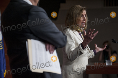 The Used Photo - Speaker of the United States House of Representatives Nancy Pelosi (Democrat of California) right offers remarks while joined by US Senate Minority Leader Chuck Schumer (Democrat of New York) left during a press conference on the status of the COVID-19 economic stimulus package currently in negotiations with The White House and members of the GOP leadership at the US Capitol in Washington DC Thursday August 6 2020 Credit Rod Lamkey  CNPAdMedia
