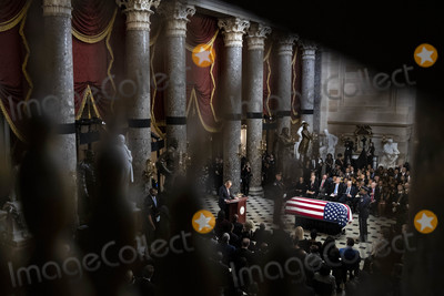 American Flag Photo - United States Senate Minority Leader Chuck Schumer (Democrat of New York) center speaks near the American flag-draped casket of US Representative Elijah Cummings (Democrat of Maryland) during a memorial service in National Statuary Hall at the US Capitol in Washington DC US on Thursday Oct 24 2019 Cummings a key figure in Democrats impeachment inquiry and a fierce critic of US President Donald J Trump died at the age of 68 on October 17 due to complications concerning long-standing health challenges Credit Al Drago  Pool via CNPAdMedia