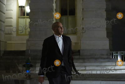 Booker Photo - United States Senator Cory Booker (Democrat of New Jersey) leaves the United States Capitol in Washington DC US on Wednesday March 25 2020  The Senate voted to pass a two trillion dollar Coronavirus Stimulus Package after days of delays and negotiations  Credit Stefani Reynolds  CNPAdMedia