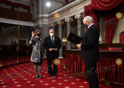 Jeanne Shaheen Photo - United States Senator Jeanne Shaheen (Democrat of New Hampshire) participates in a mock swearing-in for the 117th Congress with Vice President Mike Pence as her spouse Bill Shaheen holds a bible in the Old Senate Chambers at the US Capitol Building in Washington DC on Sunday January 3 2021 Credit Kevin Dietsch  Pool via CNPAdMedia