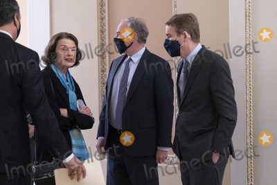 Senator Dianne Feinstein Photo - United States Senator Dianne Feinstein (Democrat of California)(L) United States Senator Tim Kaine (Democrat of Virginia)(C) and United States Senator Michael F Bennet (Democrat of Colorado) confer during a break of the US Senate Proceedings during the Second Impeachment Trial of US President Trump Credit Chris Kleponis - Pool via CNPAdMedia