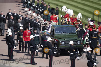 Prince Harry Photo - Photo Must Be Credited Alpha Press 073074 17042021Princess Anne Princess Royal Prince Charles Prince of Wales Prince Andrew Duke of York Prince Edward Earl of Wessex Prince William Duke of Cambridge Peter Phillips Prince Harry Duke of Sussex Lord Viscount Linley Earl of Snowdon David Armstrong-Jones Viscount Lord David Linley and Vice-Admiral Sir Timothy Laurence follow Prince Philip Duke of Edinburghs coffin on a modified Jaguar Land Rover during the funeral of Prince Philip Duke of Edinburgh at St Georges Chapel in Windsor Castle in Windsor Berkshire No UK Rights Until 28 Days from Picture Shot Date AdMedia