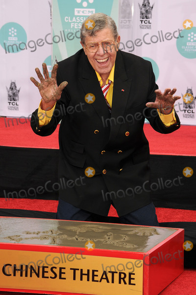 TCL Chinese Theatre Photo - 20 August 2017 - Jerry Lewis the brash slapstick comic who became a pop culture sensation in his partnership with Dean Martin and then transformed himself into an auteur filmmaker of such comedic classics as The Nutty Professor and The Bellboy has died in Las Vegas at the age of 91 For most of his career Lewis was a complicated and sometimes polarizing figure An undeniable comedic genius he pursued a singular vision and commanded a rare amount of creative control over his work with Paramount Pictures and other studios He legacy also includes more than 25 billion raised for the Muscular Dystrophy Association through the annual Labor Day telethon that he made an end-of-summer ritual for decades until he was relieved of the hosting job in 2011 In addition to his most famous films Lewis also appeared in a number of notable works such as Martin Scorseses The King of Comedy but was largely offscreen from the late 60s on and was more active with his telethon and philanthropic efforts As late as 2016 Lewis continued to perform in Las Vegas where he first debuted his comedy routine back in 1949 File Photo 12 April 2014 - Hollywood California - Jerry Lewis 2014 TCM Classic Film Festival - Jerry Lewis Hand  Footprint Ceremony held at the TCL Chinese Theatre Photo Credit Byron PurvisAdMedia