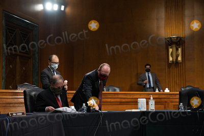 Alabama Photo - A staffer cleans the microphone for United States Senator Doug Jones (Democrat of Alabama) at a US Senate Health Education Labor and Pensions Committee hearing on new coronavirus tests on Capitol Hill in Washington Thursday May 7 2020Credit Anna Moneymaker  Pool via CNPAdMedia
