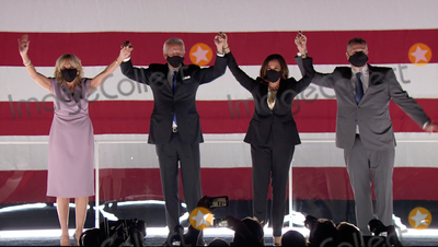 Joe Biden Photo - In this image from the Democratic National Convention video feed former United States Vice President Joe Biden the 2020 Democratic Party nominee for President of the US left center Dr Jill Biden left US Senator Kamala Harris (Democrat of California) right center and Douglas Emhoff acknowledge the crowd in the parking lot after seeing a fireworks display following Bidens acceptance speech on the last night of the convention on Thursday August 20 2020Credit Democratic National Convention via CNPAdMedia