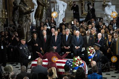 Front Row Photo - Maya Rockeymoore widow of late United States Representative Elijah Cummings (Democrat of Maryland) raises her arms over the casket of Cummings during a memorial service in National Statuary Hall at the US Capitol in Washington DC US on Thursday Oct 24 2019 Cummings a key figure in Democrats impeachment inquiry and a fierce critic of US President Donald J Trump died at the age of 68 on October 17 due to complications concerning long-standing health challenges Standing behind the casket in the front row from left to right Speaker of the US House of Representatives Nancy Pelosi (Democrat of California) US Senate Majority Leader Mitch McConnell (Republican of Kentucky) US Senate Minority Leader Chuck Schumer (Democrat of New York) US House Minority Leader Kevin McCarthy (Republican of California) US House Majority Leader Steny Hoyer (Democrat of Maryland) US House Assistant Democratic Leader James Clyburn (Democrat of South Carolina) and US Senator Ben Cardin (Democrat of Maryland)Credit Al Drago  Pool via CNPAdMedia