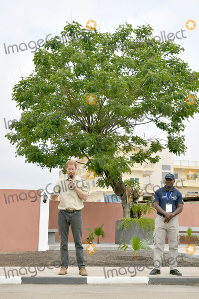 Wale Photo - 27092019 - Prince Harry Duke of Sussex delivers a speech in front of the Diana Tree in Huambo Angola on day five of the royal tour of Africa The Duke is visiting the minefield where his late mother Diana Princess of Wales was photographed in 1997 which is now a busy street with schools shops and houses Photo Credit ALPRAdMedia