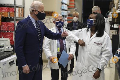 The Vaccines Photo - President Joe Biden greets Kizzmekia Corbett an immunologist with the Vaccine Research Center at the National Institutes of Health during a visit at the Viral Pathogenesis Laboratory at the National Institutes of Health on Thursday February 11 2021 in Bethesda Maryland Credit Oliver Contreras  Pool via CNPAdMedia