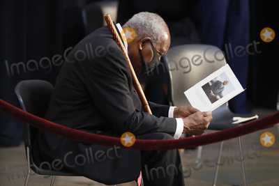 The Ceremonies Photo - United States Representative Danny Davis (Democrat of Illinois) reads the program prior to the start of the ceremony preceding the lying in state of US Representative from Georgia John Lewis in the Rotunda of the US Capitol in Washington DC USA 27 July 2020Credit Shawn Thew  Pool via CNPAdMedia
