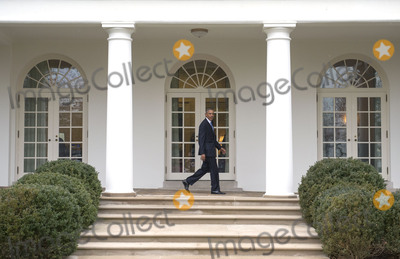 Barack Obama Photo - President Barack Obama walks on the colonnade after leaving the Oval Office for the last time as President in Washington DC on January 20 2017 Later today President-Elect Donald Trump will be sworn-in as the 45th President Photo Credit Kevin DietschCNPAdMedia