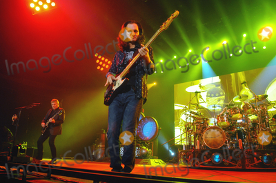 Alex Lifeson Photo - 06 July 2013 - Hamilton Ontario Canada  Geddy Lee (lead vocalist and bassist) Alex Lifeson (guitarist) and Neil Peart (drummer) of iconic Canadian rock band Rush perform on stage at Copps Coliseum Photo Credit Brent PerniacAdMedia