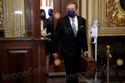 President Trump Photo - Michael van der Veen attorney for former President Donald Trump heads to the Senate Chamber before the fifth day of the impeachment trial of former President Trump on Saturday February 13 2021Credit Greg Nash - Pool via CNPAdMedia