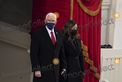 Mike Pence Photo - US Vice President Mike Pence and Second Lady Karen Pence arrive to the 59th presidential inauguration in Washington DC US on Wednesday Jan 20 2021 Biden will propose a broad immigration overhaul on his first day as president including a shortened pathway to US citizenship for undocumented migrants - a complete reversal from Donald Trumps immigration restrictions and crackdowns but one that faces major roadblocks in Congress Photographer Kevin DietschUPIBloombergAdMedia
