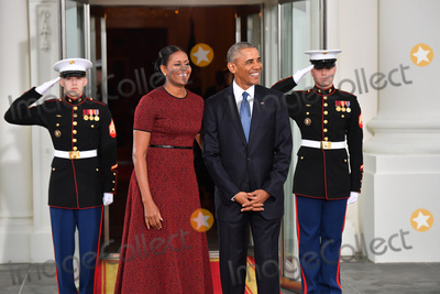 Barack Obama Photo - President Barack Obama (R) and Michelle Obama wait for President-elect Donald Trump and wife Melania at the White House before the inauguration on January 20 2017 in Washington DC  Trump becomes the 45th President of the United States Photo Credit Kevin DietschCNPAdMedia