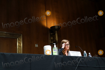 Foreigner Photo - Samantha Power nominee to be Administrator of the United States Agency for International Development adjusts her glasses as she answers questions at her confirmation hearing before the Senate Foreign Relations Committee Tuesday March 23 2021Credit Greg Nash  Pool via CNPAdMedia
