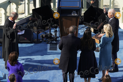 Supremes Photo - President Joe Biden flanked by his wife Jill and their family takes the oath of office from Supreme Court Chief Justice John Roberts during the 59th Presidential Inauguration at the US Capitol in Washington Wednesday Jan 20 2021 (AP PhotoSusan Walsh Pool)AdMedia