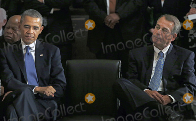 Barack Obama Photo - United States President Barack Obama left and the current Speaker of the US House John Boehner (Republican of Ohio) right attend a memorial service honoring former Speaker of the US House Thomas S Foley (Democrat of Washington) in the US Capitol in Washington DC on October 29 2013   Foley represented Washingtons 5th Congressional District was the 57th Speaker of the US House of Representatives from 1989 to 1995 He later served as US Ambassador to Japan from 1997 to 2001 US Representative John Lewis (Democrat of Georgia) is at the far left behind President ObamaCredit Aude Guerrucci  Pool via CNPAdMedia