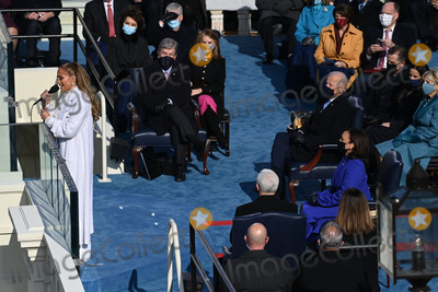 JENNIFER LOPEZ Photo - US Singer Jennifer Lopez sings at the Inauguration ceremony of the 46th US President on January 20 2021 at the US Capitol in Washington DC - Biden a 78-year-old former vice president and longtime senator takes the oath of office at noon (1700 GMT) on the US Capitols western front the very spot where pro-Trump rioters clashed with police two weeks ago before storming Congress in a deadly insurrection (Photo by Saul LOEB  POOL  AFP)AdMedia