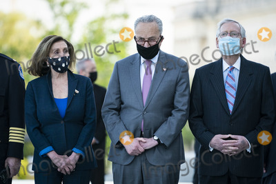 Representative Nancy Pelosi Photo - WASHINGTON DC - APRIL 13 Speaker of the United States House of Representatives Nancy Pelosi (Democrat of California) US Senate Majority Leader Chuck Schumer (Democrat of New York) and US Senate Minority Leader Mitch McConnell (Republican of Kentucky) wait for the departure of Capitol Police Officer William Billy Evans after laying in Honor on Capitol Hill on Tuesday April 13 2021 in Washington DC Credit Jabin Botsford  Pool via CNPAdMedia