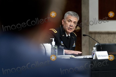 Josh Hawley Photo - United States Cyber Command Commander National Security Agency Director and Central Security Service Chief Gen Paul Nakasone answers a question asked by Sen Josh Hawley R-Mo foreground during a hearing to examine United States Special Operations Command and United States Cyber Command in review of the Defense Authorization Request for fiscal year 2022 and the Future Years Defense Program on Capitol Hill Thursday March 25 2021 in WashingtonCredit Andrew Harnik  Pool via CNPAdMedia