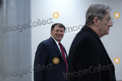 Kennedy Photo - United States Senator Mike Rounds (Republican of South Dakota) left and United States Senator John Kennedy (Republican of Louisiana) walk through the Senate Subway at the United States Capitol in Washington DC US on Wednesday March 25 2020  The Senate voted to pass a two trillion dollar Coronavirus Stimulus Package after days of delays and negotiations  Credit Stefani Reynolds  CNPAdMedia