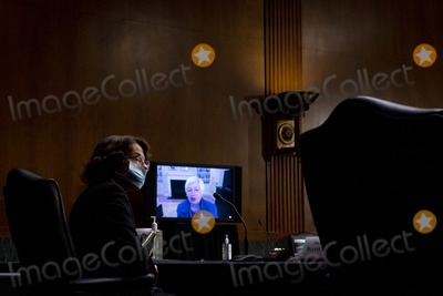 Dianne Feinstein Photo - Sen Dianne Feinstein D-Calif left listens to Janet Yellen give her opening statement via videoconference during a Senate Finance Committee hearing to examine the expected nomination of Janet Yellen to be Secretary of the Treasury on Capitol Hill in Washington Tuesday Jan 19 2021 Credit Andrew Harnik - Pool via CNPAdMedia