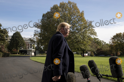 Alabama Photo - US President Donald J Trump walks away after delivering brief remarks to members of the news media before departing with First Lady Melania Trump (not pictured) on the South Lawn of the White House  in Washington DC USA 09 November 2019 The President and First Lady will attend a National Collegiate Athletic Association (NCAA) football game between Alabama and Louisiana State University in Tuscaloosa Alabama then they will stay in New York City through Veterans DayCredit Michael Reynolds  Pool via CNPAdMedia
