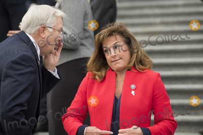 Alabama Photo - United States Representative Lisa McClain (Republican of Michigan) right shares a laugh with United States Representative Jerry Carl (Republican of Alabama) left as they join other freshmen GOP members of Congress for a group photograph on the East Front Steps of the US Capitol in Washington DC Monday January 4 2021 Credit Rod Lamkey  CNPAdMedia