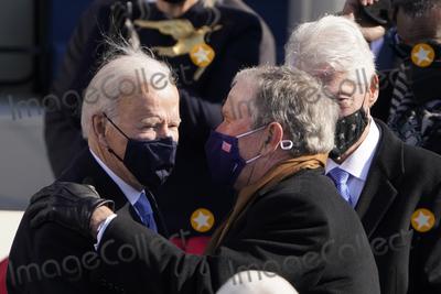 Bill Clinton Photo - President Joe Biden talks with former Presidents George Bush and Bill Clinton after the 59th Presidential Inauguration at the US Capitol in Washington Wednesday Jan 20 2021 (AP PhotoPatrick Semansky Pool)AdMedia