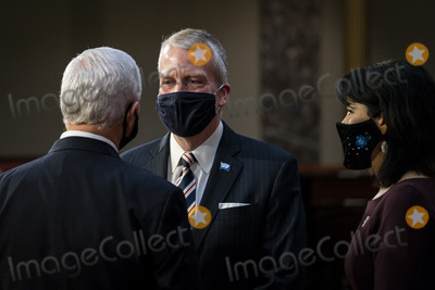 Alaska  Photo - United States Vice President Mike Pence speaks with US Senator Dan Sullivan (Republican of Alaska) and his wife Julie Fate during a mock swearing-in ceremony in the Old Senate Chamber on Capitol Hill on January 3 2021 in Washington DC Credit Pete Marovich  Pool via CNPAdMedia