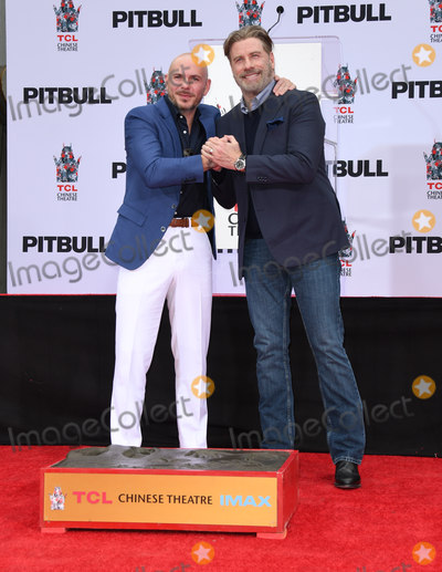 TCL Chinese Theatre Photo - 14 December 2018 - Hollywood California - Pitbull John Travolta Pitbull Hand And Footprint Ceremonyheld at TCL Chinese Theatre Photo Credit Birdie ThompsonAdMedia
