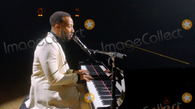 John Legend Photo - In this image from the Democratic National Convention video feed American singer-songwriter John Legend performs to close the second night of the convention on Tuesday August 18 2020Credit Democratic National Convention via CNPAdMedia