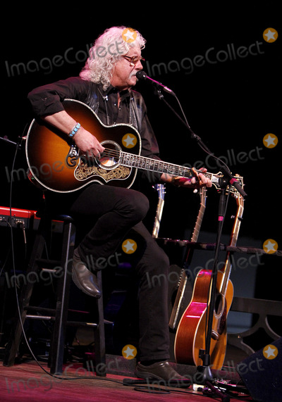 Arlo Guthrie Photo - May 9 2013 - Madison WI - Folk artist and activist Arlo Guthrie made a stop at the Barrymore Theatre in Madison WI where he performed music from his fathers catalog in honoro of Woody Guthries 100th birthday Photo credit Dan HarrAdMedia