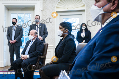 Andrew Cuomo Photo - Mayor Mike Duggan (D-Detroit MI) left and Mayor Keisha Lance Bottoms (D-Atlanta GA) center look on as President Joe Biden and Vice President Kamala Harris meet with governors and mayors in the Oval Office in Washington DC on Friday Feb 12 2021 to discuss the vital need to pass the American Rescue Plan which will get more support to their communities and those on the front lines of the fight against COVID-19 Attending whereGovernor Andrew Cuomo (D-NY) Governor Asa Hutchinson (R-AR)Governor Michelle Lujan Grisham (D-NM)Governor Larry Hogan (R-MD)Mayor Keisha Lance Bottoms (D-Atlanta GA)Mayor Latoya Cantrell (D-New Orleans LA)Mayor Mike Duggan (D-Detroit MI)Mayor Francis Suarez (R-Miami FL)Mayor Jeff Williams (R-Arlington TX) Credit Pete Marovich  Pool via CNPAdMedia