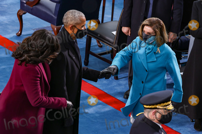 Barack Obama Photo - WASHINGTON DC - JANUARY 20 Former US President Barack Obama and former first lady Michelle Obama greet Speaker of the House Nancy Pelosi (D-CA) at the inauguration of US President-elect Joe Biden on the West Front of the US Capitol on January 20 2021 in Washington DC  During todays inauguration ceremony Joe Biden becomes the 46th president of the United States (Photo by Tasos KatopodisGetty Images)AdMedia