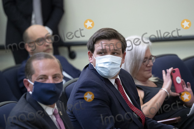 Alex Azar Photo - United States Secretary of Health and Human Services (HHS) Alex Azar and Governor Ron DeSantis (Republican of Florida) center wear protective face masks while attending an executive order signing ceremony on lowering drug prices in the Eisenhower Executive Office Building in Washington DC US on Friday July 24 2020 Lowering prescription drug prices is a top priority of Trump including a policy to tie Medicare payments to foreign countries drug prices Credit Stefani Reynolds  Pool via CNPAdMedia
