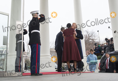 President Barack Obama Photo - President-elect Donald Trump kisses First Lady Michelle Obama as hi and his wife Melania are greeted by President Barack Obama and the First Lady as they arrive at the White House prior to his inauguration in Washington DC on January 20 2017 Later today Donald Trump will be sworn-in as the 45th President Photo Credit Kevin DietschCNPAdMedia