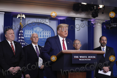 Alex Azar Photo - United States President Donald J Trump speaks during a Coronavirus Task Force news conference in the briefing room of the White House in Washington DC US on Friday March 20 2020 Americans will have to practice social distancing for at least several more weeks to mitigate US cases of Covid-19 Director of the National Institute of Allergy and Infectious Diseases at the National Institutes of Health Dr Anthony Fauci said today From left to right behind the President US Secretary of State Mike Pompeo US Vice President Mike Pence Director of the National Institute of Allergy and Infectious Diseases at the National Institutes of Health Dr Anthony Fauci and US Secretary of Health and Human Services (HHS) Alex AzarCredit Al Drago  Pool via CNPAdMedia
